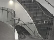 Stainless steel handrail and glass balustrade stair well access Christchurch manufactured